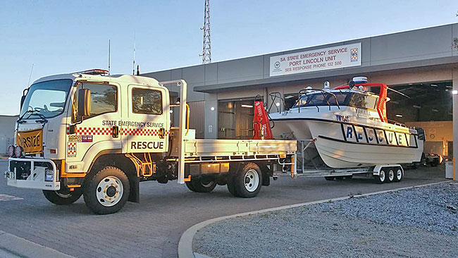 SA State Emergency Service rescue vehicle and boat in front of the Port Lincoln Unit building