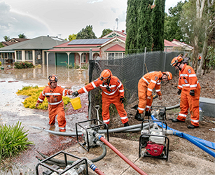 SA SES volunteers from across Metro Adelaide helped clean up the area after burst water mains caused flooding in Paradise, South Australia. Image taken March 2016.